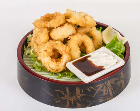Deep batter fried squid rings calamari with green salad Stock Photo - 13079477