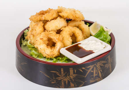 Deep batter fried squid rings calamari with green salad Stock Photo - 13079404