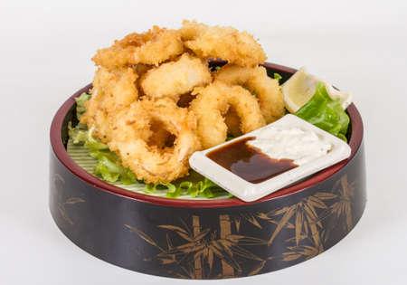 Deep batter fried squid rings calamari with green salad Stock Photo - 13079404