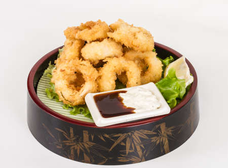 Deep batter fried squid rings calamari with green salad Stock Photo - 13079247