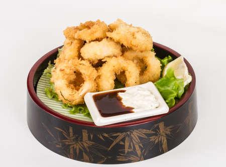 Deep batter fried squid rings calamari with green salad Stock Photo - 13079247