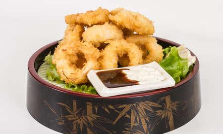 Deep batter fried squid rings calamari with green salad Stock Photo - 13079274