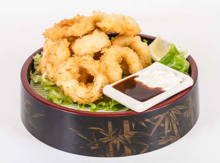 Deep batter fried squid rings calamari with green salad Stock Photo - 13079479