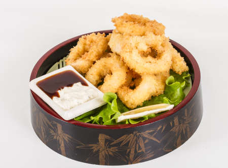 Deep batter fried squid rings calamari with green salad Stock Photo - 13079338