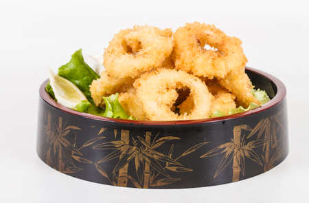 Deep batter fried squid rings calamari with green salad Stock Photo - 13079460