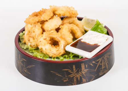 Deep batter fried squid rings calamari with green salad Stock Photo - 13079513