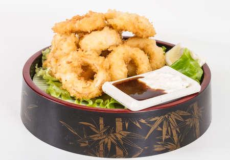 Deep batter fried squid rings calamari with green salad Stock Photo - 13079447