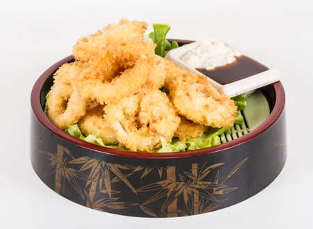 Deep batter fried squid rings calamari with green salad Stock Photo - 13079484