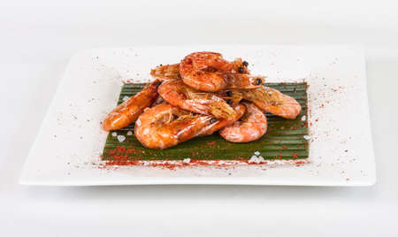 fried black tiger prawns with herbs and spices on banana leaf Stock Photo - 13078796