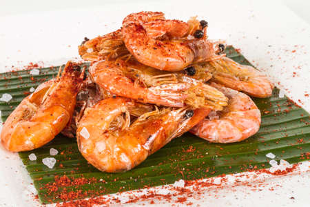 fried black tiger prawns with herbs and spices on banana leaf Stock Photo - 13079921