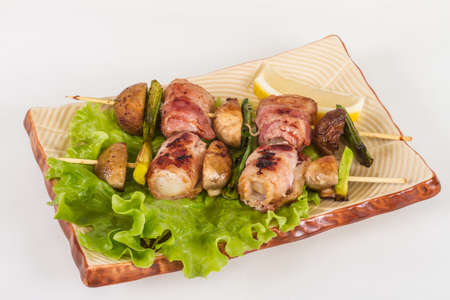 Bacon wrapped grilled Scallops with mushrooms and bacon photo