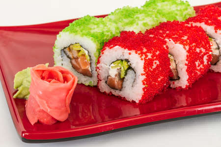 fish type: Tobiko Spicy Maki Sushi - Hot Roll with various type of Tobiko (flying fish roe) outside and salmon inside