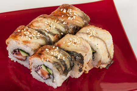 Japanese traditional Cuisine - Maki Roll with Cucumber , Cream Cheese and Raw Salmon and Eel photo