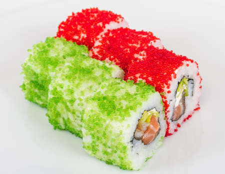 Tobiko Spicy Maki Sushi - Hot Roll with various type of Tobiko (flying fish roe) outside and salmon inside photo
