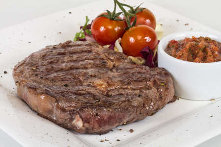Grilled Beef Steak Isolated On a White Background photo