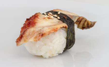 Eel sushi. Isolated over white. photo