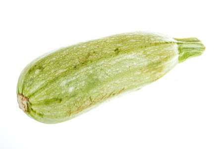 Single Courgette or zucchini from low perspective isolated on white. photo