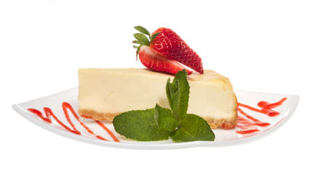 a piece of strawberry cheesecake on whit photo