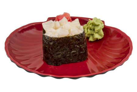 hotate: spice sushi hotate with sauced slices of scallop isolated on white background