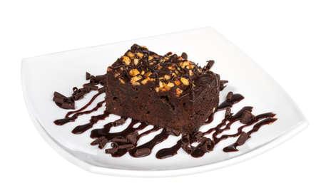 brownie: pastel de trufa con salsa de chocolate negro Foto de archivo