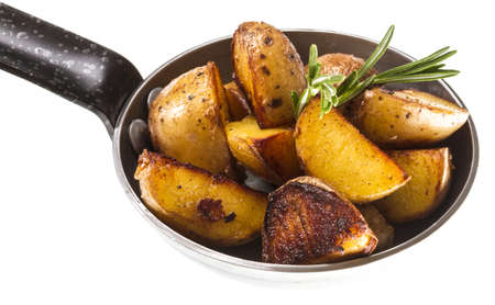 fried potato wth rosmarin Stock Photo - 13634215