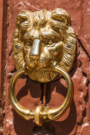 lionhead knocker found on a door of a classical mansion in Budapest photo