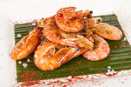 fried black tiger prawns with herbs and spices on banana leaf Stock Photo - 13788093