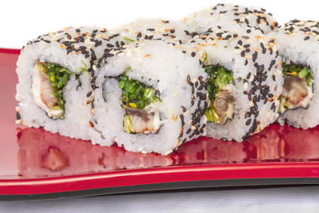 Japanese traditional Cuisine - Maki Roll with Nori , Cream Cheese and Eel. Isolated over white background photo