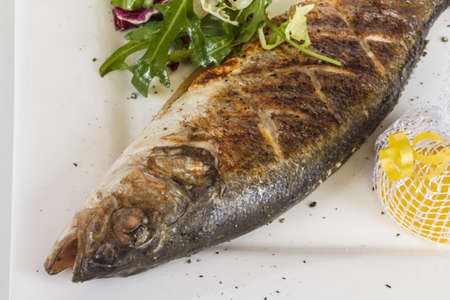 Sea-bass with vegetables photo