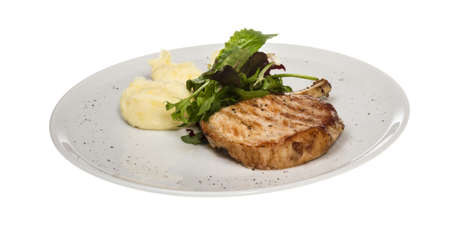 Grilled pork with salad and potato