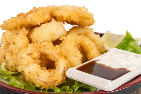 Deep batter fried squid rings calamari with green salad photo