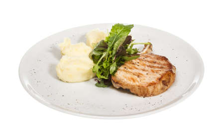 Grilled pork with salad and potato Stock Photo - 14034555