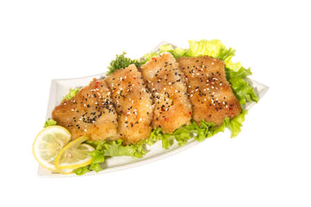 Roasted fish with lemon Stock Photo - 14034653