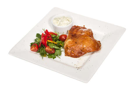 roasted chicken with vegetables on a white plate photo