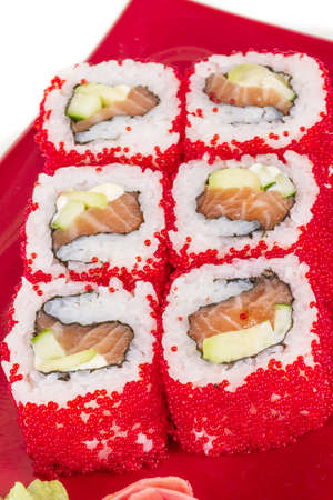 Tobiko Spicy Maki Sushi - Hot Roll with various type of Tobiko (flying fish roe) outside. Salmon, avocado and Green Lettuce inside Stock Photo - 14055905