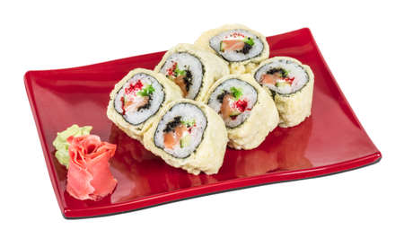 Japanese Cuisine -Tempura Maki Sushi (Deep Fried Roll made of salmon, tobiko roe and Cream Cheese inside) photo