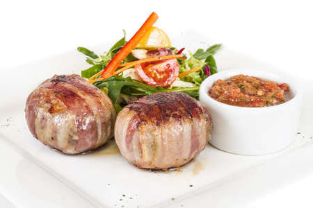 Grilled steak wrapped in bacon, with grilled vegetables, mashed potatoes photo