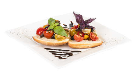 juicy tomatoes on fresh bread, pesto as topping photo