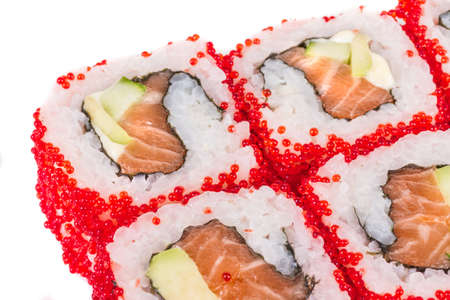 Tobiko Spicy Maki Sushi - Hot Roll with various type of Tobiko (flying fish roe) outside. Salmon, avocado and Green Lettuce inside Stock Photo - 14069032