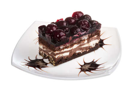 Chocolate cake with cherry on top on a white background photo