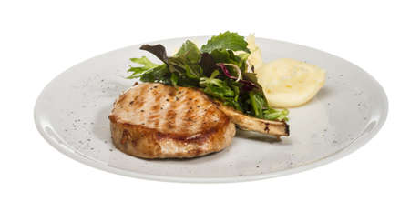 Grilled pork with salad and potato Stock Photo - 14069056