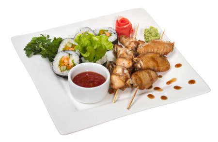 Buffalo chicken wings on plate with sushi photo