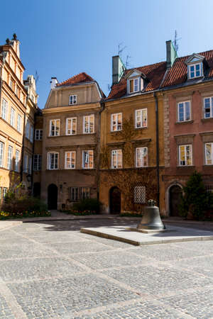 View towards the old town of Warsaw in Poland showing the old cracked bell from the cathedral now in a town square