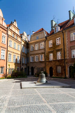 View towards the old town of Warsaw in Poland showing the old cracked bell from the cathedral now in a town square photo