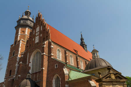 Cracow - Corpus Christi Church was founded by Kasimirus III The Great about 1340. The front elevation has a gothic gable whilst decoration of the interior is baroque photo