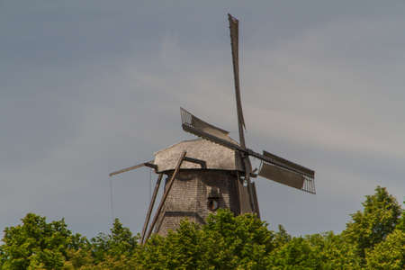 old windmill in park sanssouci palace in Potsdam, Germany photo