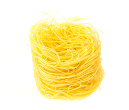 twists: A portion of tagliatelle italian pasta isolated on white
