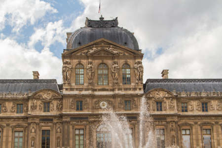 consistently: PARIS - JUNE 7: Louvre building on June 7, 2012 in Louvre Museum, Paris, France. With 8.5m annual visitors, Louvre is consistently the most visited museum worldwide. Stock Photo