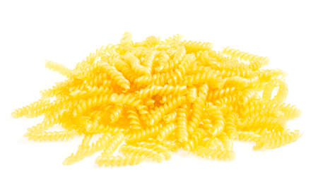 pile of fusilli pasta close up on wood background photo
