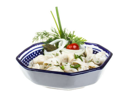 Bowl with traditional russian dish - pelmeni (dumplings) photo